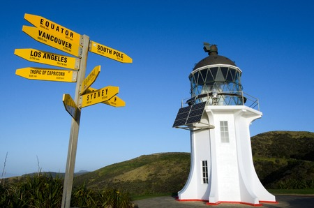 new horizons: Directions to the world and  Cape Reinga lighthouse at the edge of the northland of New Zealand.