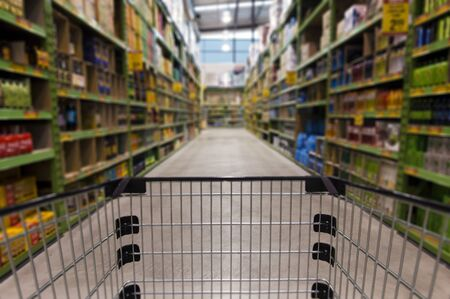 merchandising: An empty shopping trolley cart in a supermarket. Stock Photo