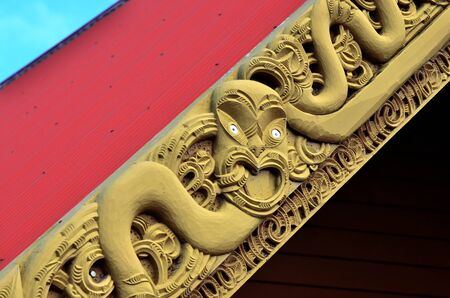 wood carvings: Traditional Maori wood carvings in a Marae (meeting house) in New Zealand. Stock Photo