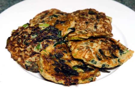 yiddish: Spinach pancake (Latkes in Yiddish) a traditional Jewish dish for Rush Hashanah the Jewish New Year dinner.