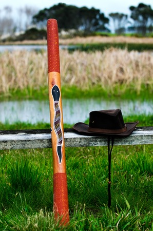 wind instrument: An Australian hat and Didgeridoo wind instrument in the wild Australian outback. Stock Photo