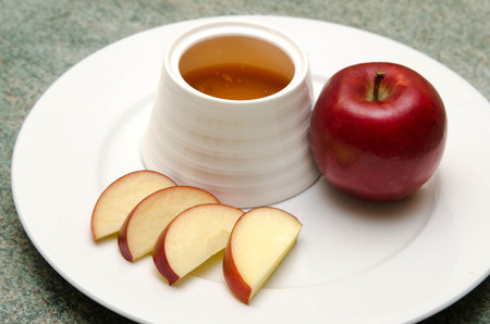 jewish food: Traditional jewish food, apple and honey for the holiday of Rosh Hashana (Jewish New Year).