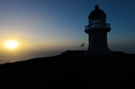 Cape Reinga Lighthouse during sunset in northland, New Zealand. photo