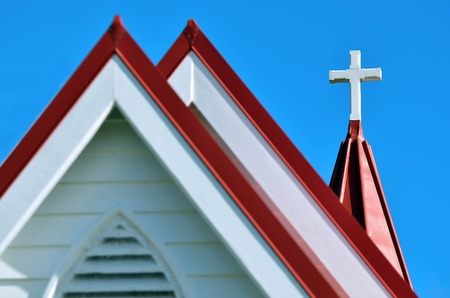 anglican: A cross on top of an Anglican Church. Stock Photo