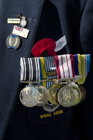 nz: Close up of a NZ veteran soldier medals  during a National War Memorial Anzac Day services in New Zealand.