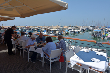 yaffo: TEL AVIV, ISR - MAR 24 2015:People dinning at the old port of Jaffa in Tel Aviv Jaffa, Israel.It's ancient port city in Israel famous for its beauty and ancient history. Editorial