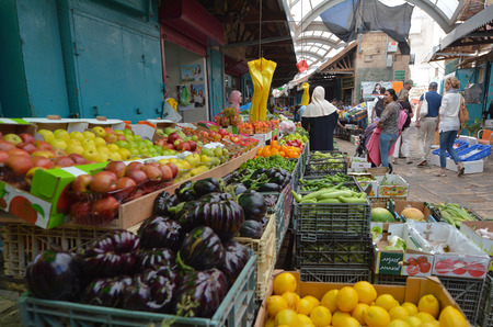 akko: ACRE, ISR - APR 21 2015:People shopping at acre old market in Akko, Israel. Acre is one of the oldest continuously inhabited sites in the world.