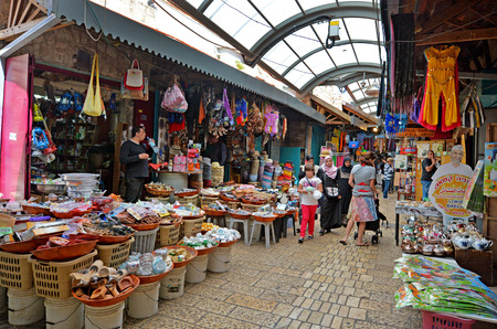 continuously: ACRE, ISR - APR 21 2015:People shopping at acre old market in Akko, Israel. Acre is one of the oldest continuously inhabited sites in the world.