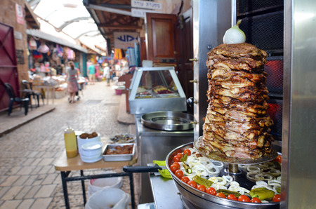 continuously: ACRE, ISR - APR 21 2015:Levantine Arab meat Shawarma on display at acre old market in Akko, Israel. Acre is one of the oldest continuously inhabited sites in the world. Editorial