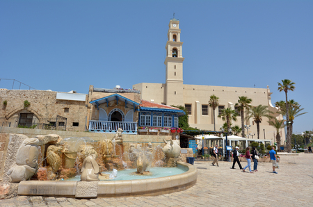 echoes: TEL AVIV, ISR - MAR 24 2015:Visitors at the Zodiac Fountain in Kedumim Square in Old Jaffa, Tel Aviv, Israel.The fountain echoes the zodiac theme of Jaffas Old City. Editorial