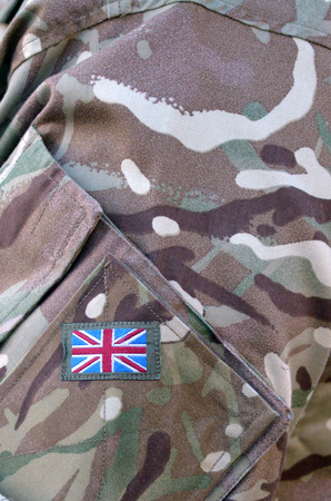 armed services: British Army soldier camouflage uniform with the national British Flag  Badge on It. background texture