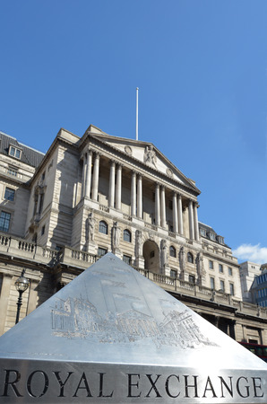 the central bank: Royal exchange pyramid against the Bank of England Central Bank Headquarters faced in City of London, UK. copyscape Editorial
