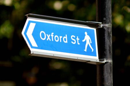 oxford street: Arrow sign show pedestrians the way to Oxford street the most famous famous shopping street in London England and the United Kingdom.