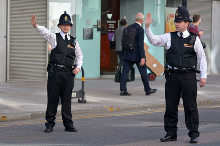 police force: LONDON - MAY 18 2015:City of London Police officers.With only 750 full-time police officers and 70 special constables in 3 police stations, City of London Police is the smallest police force in UK.