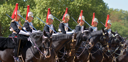 cavalry: LONDON, UK - MAY 13 2015:Mounted troopers of the Household Cavalry during ceremony at Horse Guards.The soldiers charged with guarding the official royal residences in the United Kingdom.