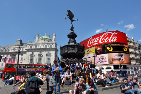 piccadilly: LONDON, UK - MAY 14 2015:Visitors in Piccadilly Circus London, UK.With nearly 100 million tourists visiting Piccadilly each year it one of the most famous intersections in the entire world Editorial