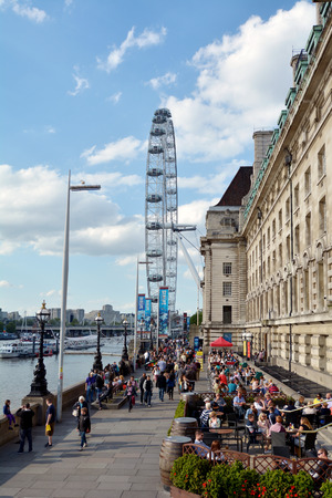 sea life centre: LONDON, UK - MAY 15 2015: London Eye and London County Hall in London UK.County Hall is the site of businesses and attractions, including the London Sea Life Aquarium and London Eye visitor centre