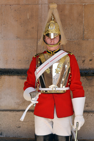 royals: LONDON, UK - MAY 13 2015:Trooper of the Blues and Royals performing ceremonial duties at Horse Guards.The soldiers is charged with guarding the official royal residences in the United Kingdom. Editorial
