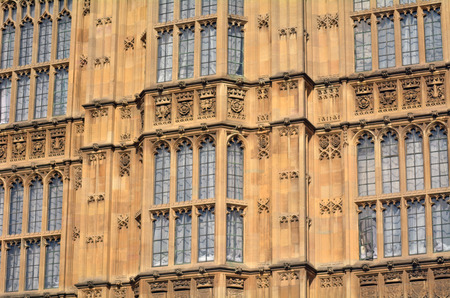 two faced: LONDON - MAY 14 2015: Palace of Westminster faced in London, England UK.Its the meeting place of the House of Commons and the House of Lords, the two houses of the Parliament of the United Kingdom.