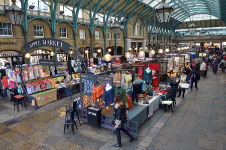 covent garden market: LONDON - MAY 15 2015:Visitors in Apple Market in Covent Garden in London, UK. The Apple Market is sells arts and crafts dedicated to antiques and collectables items. Editorial