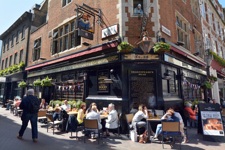 westminster city: LONDON - MAY 14 2015:People drink at Shakespeares Head pub in Carnaby Street London UK.Carnaby Street is a popular pedestrianised shopping street in the City of Westminster, London Editorial