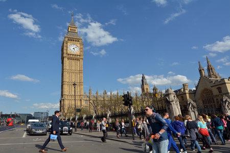 renamed: LONDON - MAY 14 2015:Visitors under the Big Ben clock tower. In 2012 - St. Stephens Tower is renamed Elizabeth Tower in honor of Queen Elizabeth IIs Diamond Jubilee, or 60th anniversary on the throne. Editorial