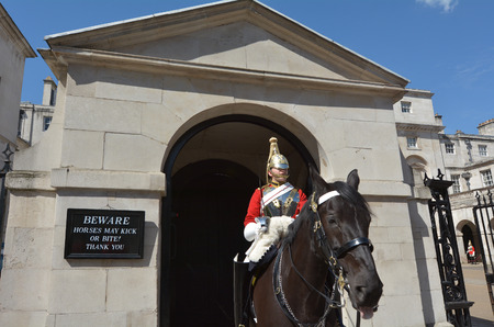 charged: LONDON, UK - MAY 13 2015:A mounted trooper of the Household Cavalry on duty at Horse Guards.The soldiers charged with guarding the official royal residences in the United Kingdom. Editorial