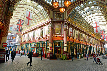 cobbled: LONDON - MAY 13 2015:Pedestrians in Leadenhall Market in London, UK.Its one of the oldest markets in London, dating back to the 14th century, located in the historic centre of the City of London.