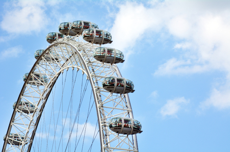 10 12: LONDON - MAY 12 2015:Visitors in a ovoidal capsules of London Eye in London, UK.Each of the 32 ovoidal capsules weighs 10 tonnes and can carry 25 people