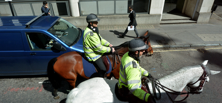 warned: LONDON - MAY 12 2015:Metropolitan Police Service Mounted officers.Police across Britain have been put on high alert and warned that they may be targeted in terror attacks Editorial