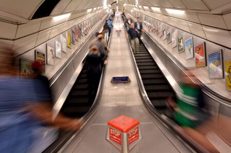 LONDON, UK - MAY 12 2015:Passengers on London Underground escalator. The Deepest station below street level is Hampstead (Northern line) - 58.5 metres. Editorial