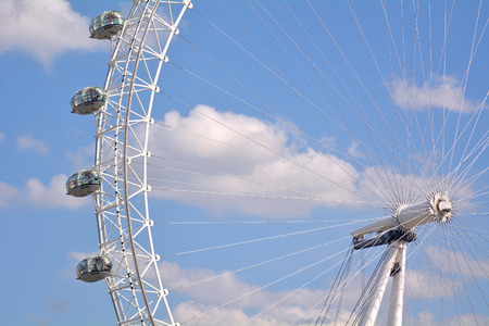 comparable: LONDON - MAY 12 2015:Visitors in a ovoidal capsule of London Eye in London, UK.The London Eye can carry 800 people each rotation, which is comparable to 11 London red double decker buses