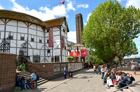 globe theatre: LONDON, UK - MAY 13 2015:Visitors at Globe Theatre in London England UK.The building have special permission for its thatched roof as there is a law against it in London since the Great Fire in 1666.