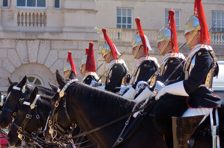 residences: LONDON, UK - MAY 13 2015:Mounted troopers of the Household Cavalry during ceremony at Horse Guards.The soldiers charged with guarding the official royal residences in the United Kingdom.