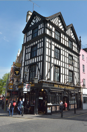 chiefly: LONDON - MAY 14 2015:Half-timbered building in Soho london, UK.The half-timber house, is a type of construction of the Middle Ages in North Europe, used chiefly for dwellings.