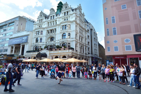 westend show: LONDON - MAY 13 2015:Street dancing show in Leicester Square London UK.The square is the prime location in London for world leading film premi�res and co-hosts the London Film Festival each year.