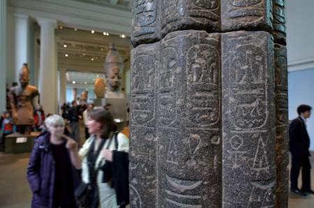 manuscripts: LONDON - MAY 15 2015:Visitors in the British Museum.The Museum contain almost 71,000 books, manuscripts, drawings, prints and antiques taken from Greece, Rome, Egypt, and many different countries.