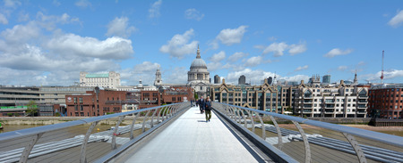 millennium bridge: LONDON, UK - MAY 12 2015:Pedestrian cross over the Millennium Bridge in London, UK. It is London first dedicated pedestrian footbridge Editorial