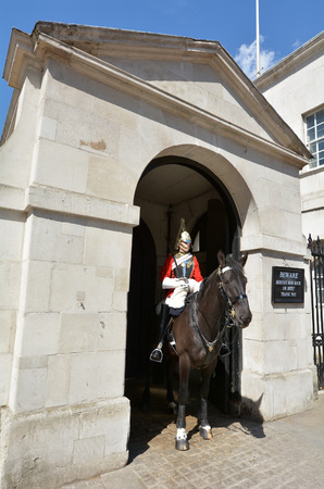 trooper: LONDON, UK - MAY 13 2015:A mounted trooper of the Household Cavalry on duty at Horse Guards.The soldiers charged with guarding the official royal residences in the United Kingdom. Editorial