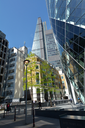 30 st mary axe: LONDON, UK - MAR 18 2015:Business people under 122 Leadenhall Street tower and 30 St Mary Axe faced in City of London, UK. Both tall office buildings recently build in the City of London financial district.