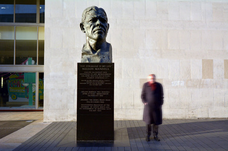 apartheid: LONDON - MAY 15 2015:Nelson Mandela sculpture at the Royal Festival Hall in London.For his activism against apartheid he received Nobel Peace Prize, Medal of Freedom and the Soviet Order of Lenin.