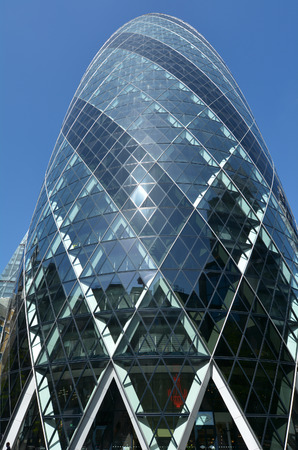 30 st mary axe: LONDON - MAY 13 2015: 30 St Mary Axe tower building. The building has become an iconic symbol of London and is one of the citys most widely recognised examples of contemporary architecture.