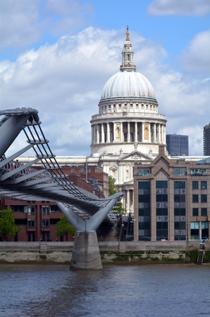 millennium bridge: LONDON - MAY 12 2015:St Pauls Cathedral the and Millennium Bridge, London UK.The Millennium Bridge was London�s first new Thames crossing in more than 100 years, since Tower Bridge was opened in 1894.