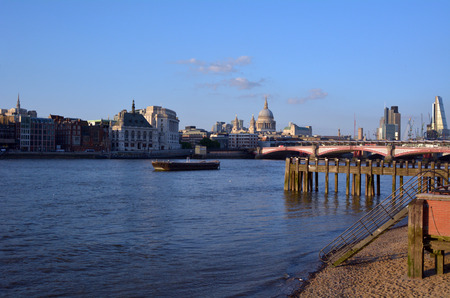st pauls: LONDON, UK - MAY 15 2015:Landscape view of St Pauls Cathedral and the and London bridge with City of London skyline. The City of London is a city and ceremonial county within London.