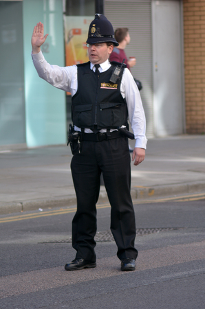 LONDON - MAY 18 2015:City of London Police officer.With only 750 full-time police officers and 70 special constables in 3 police stations, City of London Police is the smallest police force in UK.