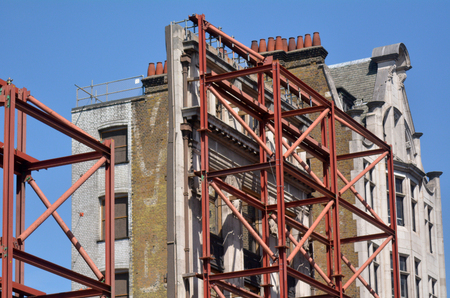 scaffolds: LONDON - MAY 14 2015:Faced of resorted old building in Oxford street in London, UK. In the UK most buildings built between 1700 and 1840 are listed as Architectural or Historic Interest.
