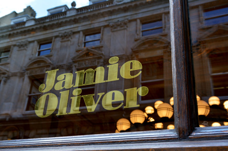 restaurateur: LONDON - MAY 13 2015:Jamie Oliver restaurant in City of London.Hes English celebrity chef and media personality known for his food shows, cookbooks and his global campaign for better food education
