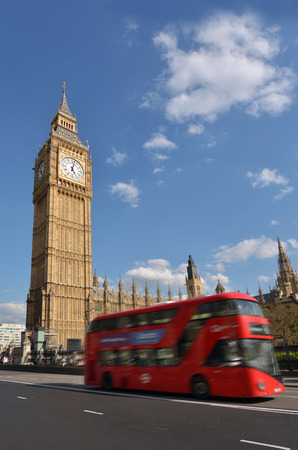 LONDON - MAY 14 2015:Red Bus under the Big Ben clock tower.Its the most popular landmark in the United Kingdom. Editöryel