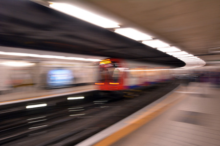 kmh: LONDON, UK - MAY 12 2015:Motion blur of London Underground train.The average scheduled train speed (including stops) is 33 kmh.