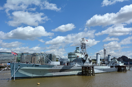 permanently: LONDON - MAY 13 2015:HMS Belfast (C35) London England UK.Its a museum ship, originally a Royal Navy light cruiser, permanently moored in London on the River Thames operated by the Imperial War Museum
